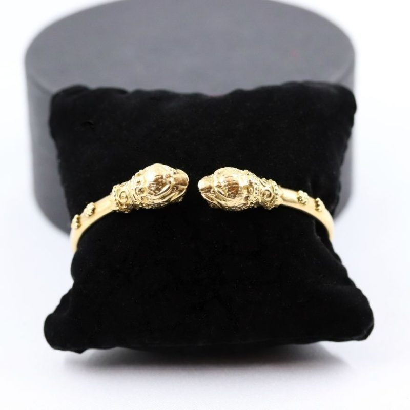 Bracelet or têtes de lions signé Zolotas