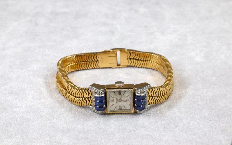 Montre de dame Movado saphirs diamants